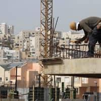פועל בניין. 18 נהרגו מתחילת השנה (צילום: נתי שוחט. פלאש 90)