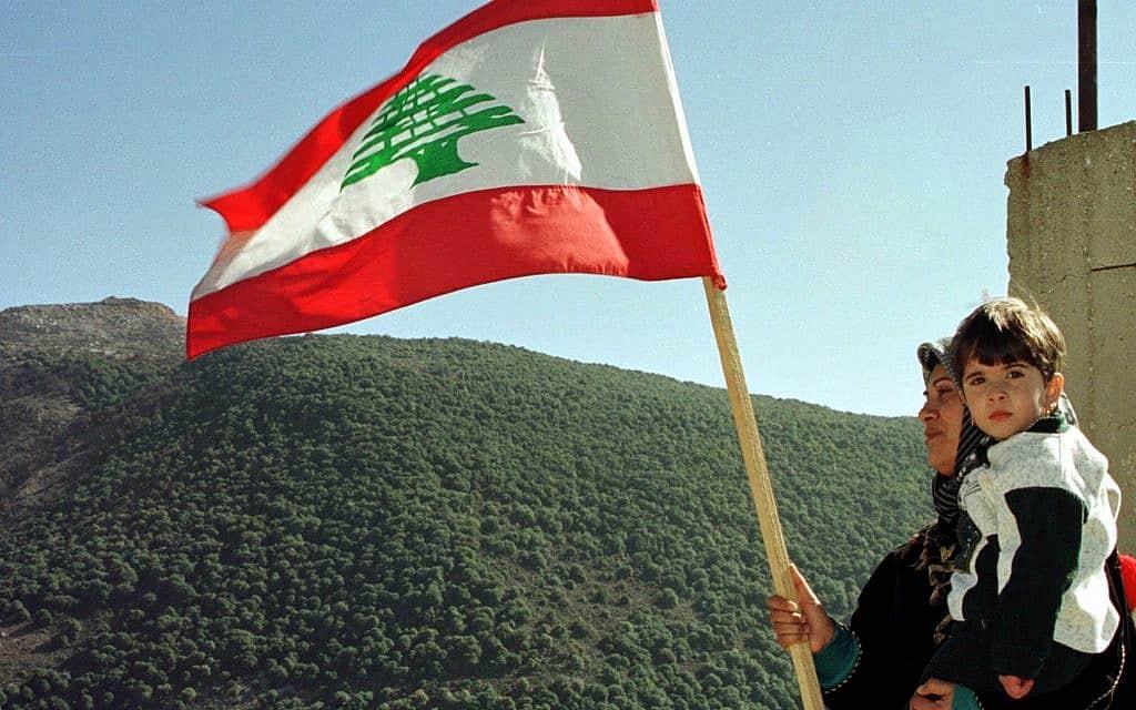"""נסיגת צה""""ל מלבנון, 2000 (צילום: AP Photo/Samer Wehbi)"""