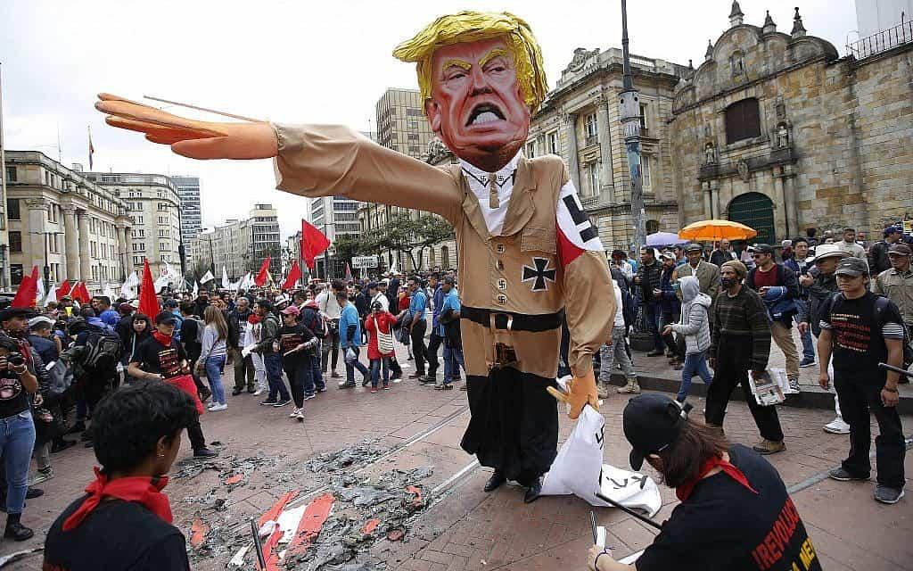 הפגנה נגד טראמפ בקולומביה, 2018 (צילום: AP Photo/Fernando Vergara)