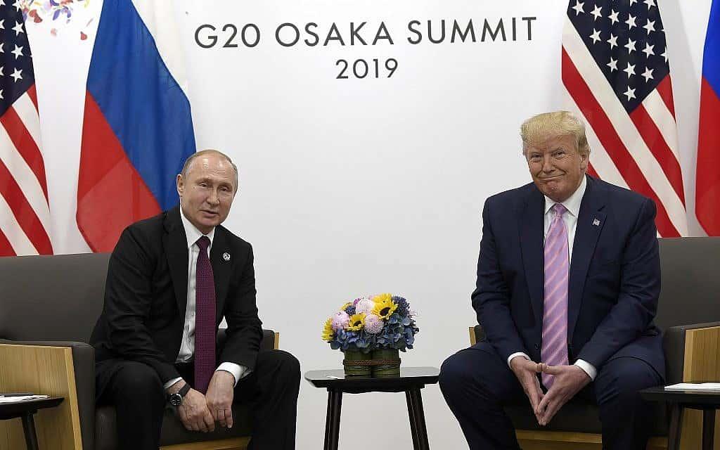 טראמפ ופוטין בפגישתם היום בוועידת G20 באוסקה (צילום: AP)
