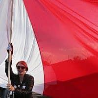 מפגינים בפולין (צילום: AP Photo/Czarek Sokolowski)