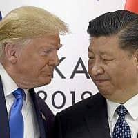 """נשיא ארה""""ב דונלד טראמפ ונשיא סין שי ג'ינפינג (צילום: Susan Walsh, AP)"""