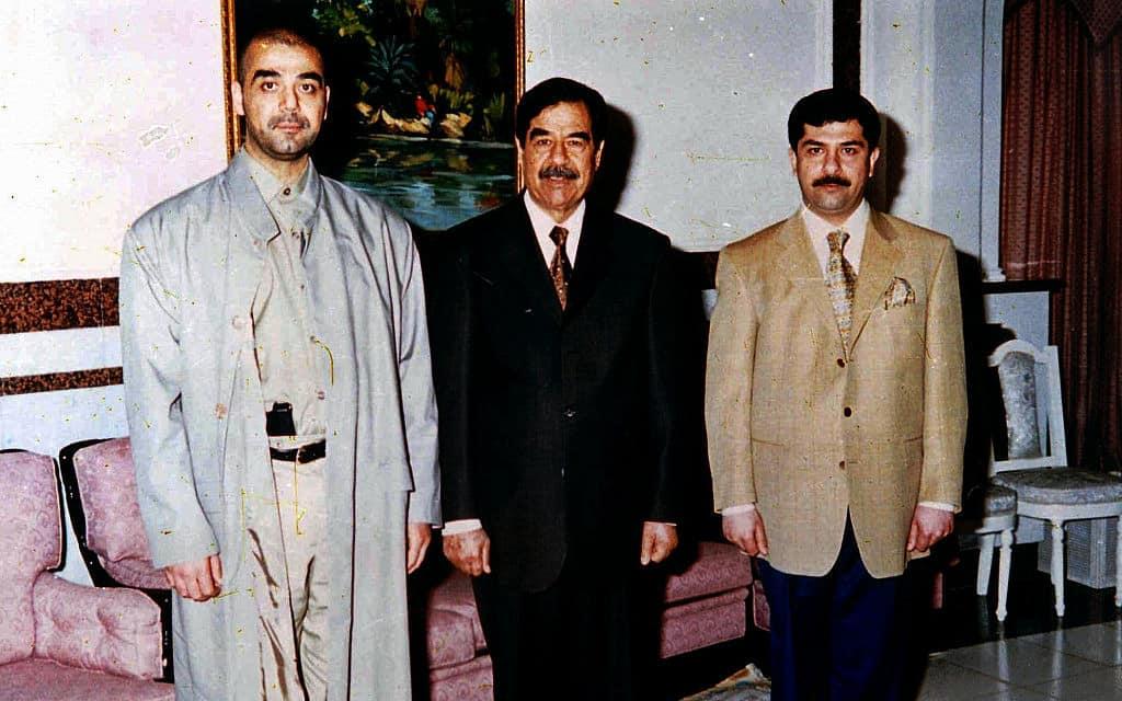סדאם חוסיין ובניו (צילום: AP Photo, File)