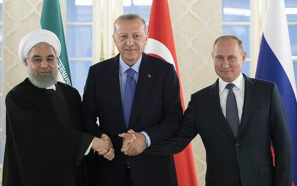 נשיא רוסיה ולדימיר פוטין, נשיא טורקיה רג׳פ טאיפ ארדואן ונשיא איראן חסן רוחאני – בפגישתם באנקרה, טורקיה, ב-16 בספטמבר 2019 (צילום: AP Photo/Pavel Golovkin)