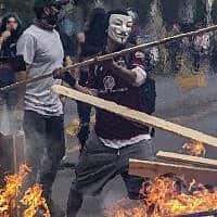 הפגנות מחאה בסנטיאגו, בירת צ'ילה (צילום: Esteban Felix, AP)