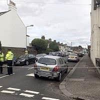 שוטרים באסקס שבבריטניה, ארכיון. למצולמים אין קשר לידיעה (צילום: Georgina Stubbs/PA via AP)