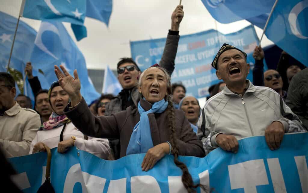 הפגנה למען זכויות האויגרים בבריסל (צילום: AP Photo/Francisco Seco)
