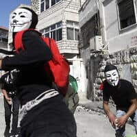 עימות בין צעירים פלסטינים למשטרה בעיסאוויה, יוני 2019 (צילום: AP Photo/Mahmoud Illean)