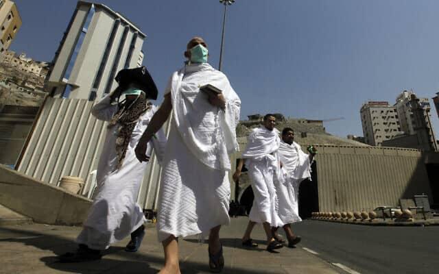 עולי רגל בסעודיה חוששים מהקורונה (צילום: AP Photo/Amr Nabil)