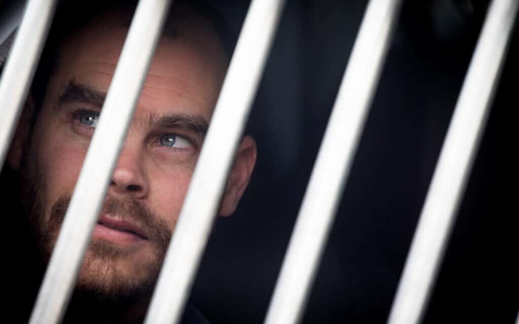 יונתן פולק במעצר (צילום: יונתן זינדל/פלאש90)