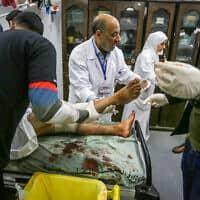 """פלסטיני שנפצע מאש צה""""ל כשניסה לאסוף גופות של אנשי הגיהאד האסלאמי, שנהרגו בגבול עזה ישראל, 23 בפברואר 2020 (צילום: Abed Rahim Khatib/Flash90)"""
