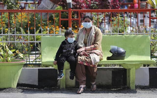 בהלת קורונה בהודו, מרץ 2020 (צילום: AP Photo/Channi Anand)