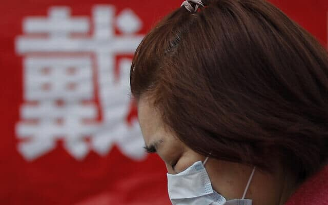 מגפת הקורונה בסין, מרץ 2020 (צילום: AP Photo/Andy Wong)