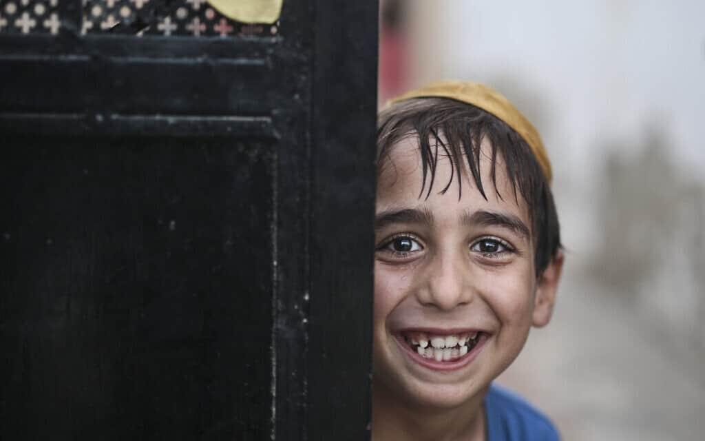 ילד יהודי בג'רבה, ארכיון, 2015 (צילום: AP Photo/Mosa'ab Elshamy, File)