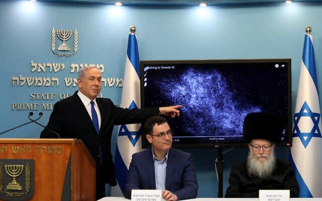 יעקב ליצמן, משה בר סימן טוב ובנימין נתניהו במסיבת עיתונאים על מגפת הקורונה, ב-11 במרץ 2020 (צילום: פלאש90)