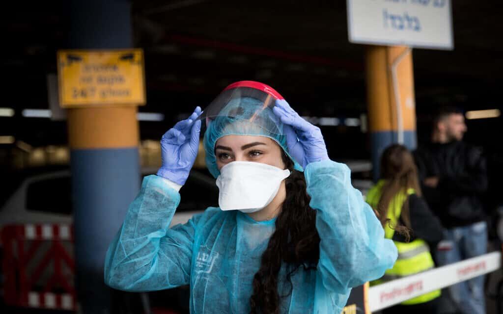 משבר הקורונה, אשת צוות בשערי צדק (צילום: Yonatan Sindel/Flash90)