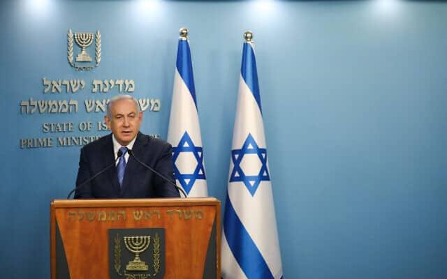 נתניהו במשרד ראש הממשלה, 25 במרץ 2020 (צילום: אוליבייה פיטוסי, פלאש 90)