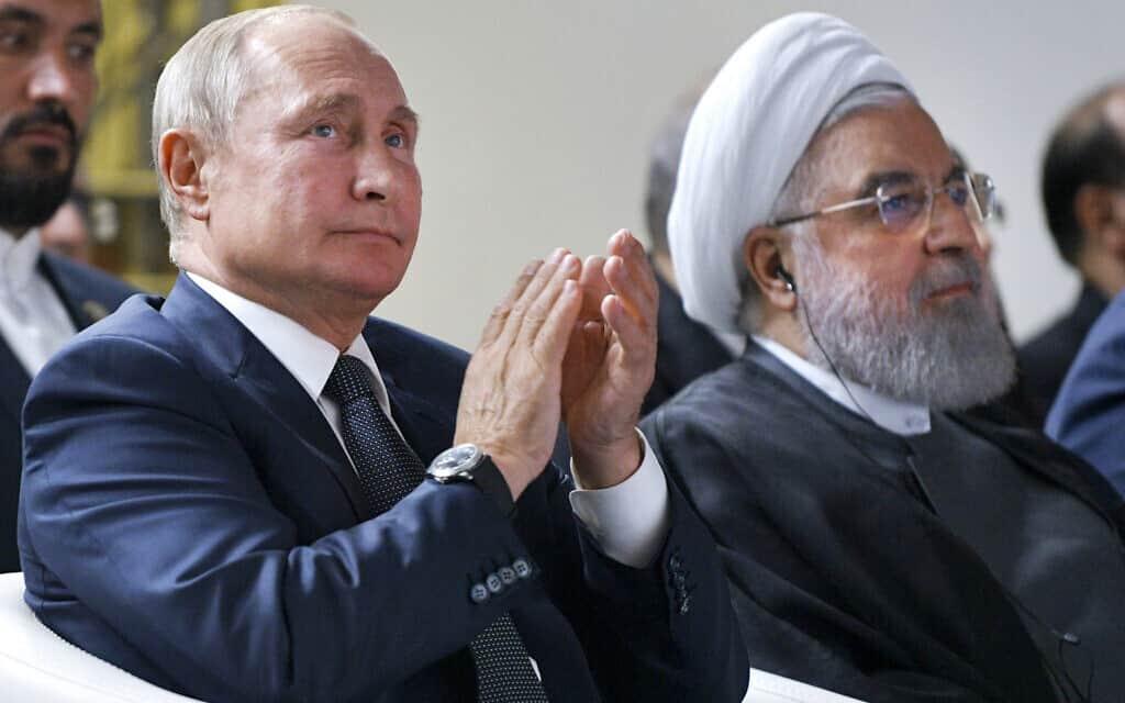 נשיא רוסיה ולדימיר פוטין, ונשיא איראן חסן רוחאני (צילום: Alexei Druzhinin, Sputnik, Kremlin Pool Photo via AP)