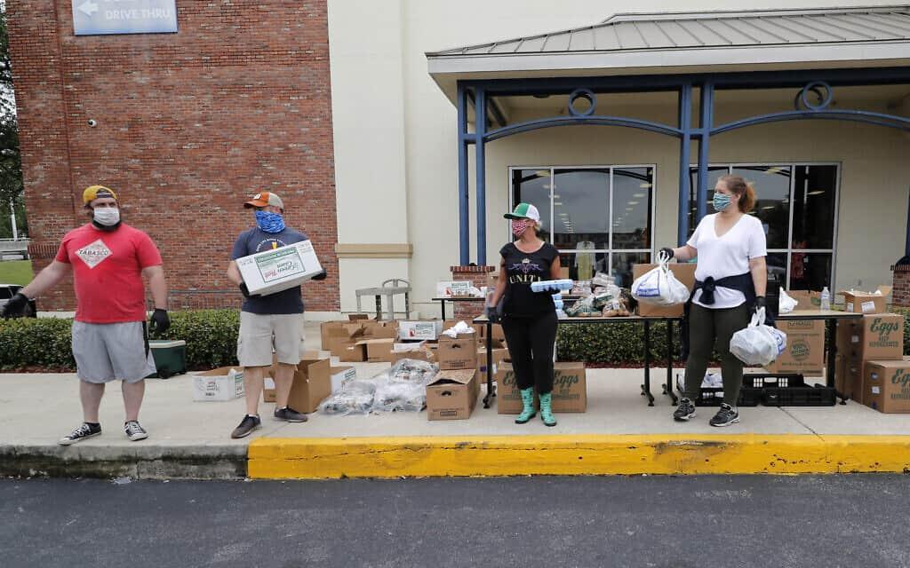 תרומת מזון לנפגעי משבר הקורונה בניו אורלינס, אילוסרטציה (צילום: AP Photo/Gerald Herbert)