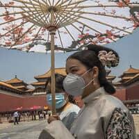 עידן הקורונה בסין, אילסוטרציה (צילום: Roman Pilipey/Pool Photo via AP)
