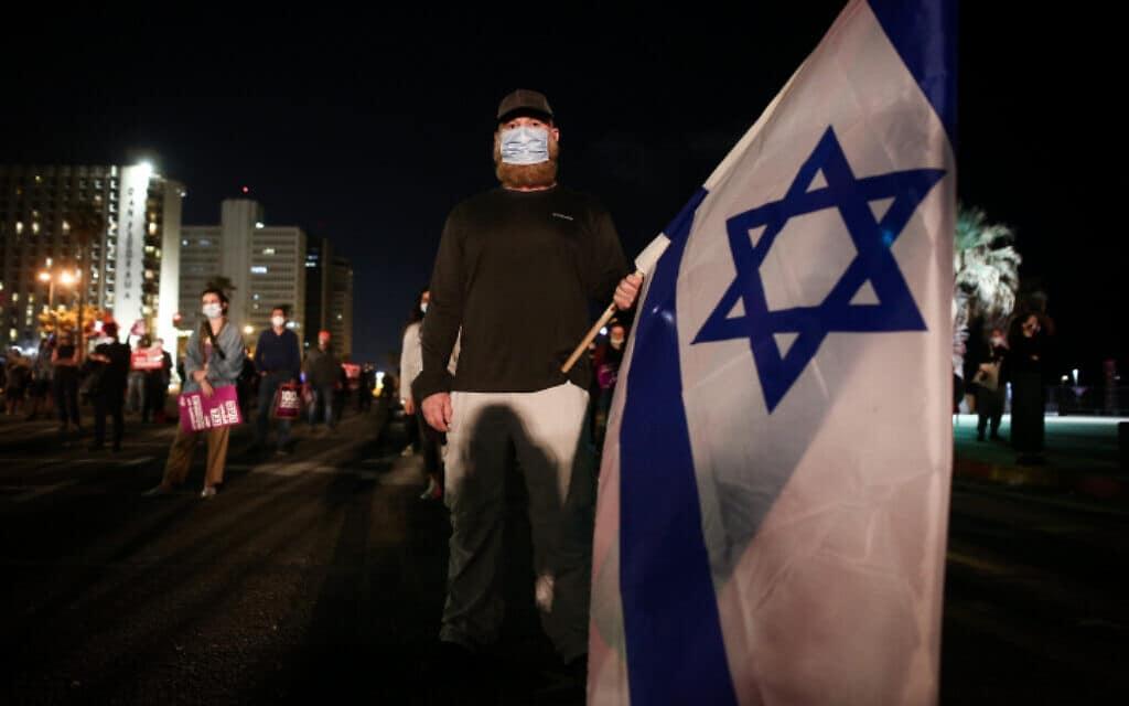 הפגנת העצמאים והשכירים, תל אביב (צילום: Flash90/מרים אלסטר)