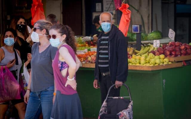משבר הקורונה: שוק הכרמל בתל אביב חוזר לפעילות (צילום: Miriam Alster/FLASH90)