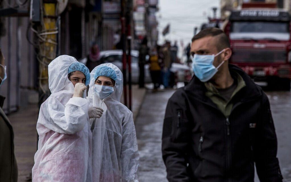 עידן הקורונה בסוריה, מרץ 2020 (צילום: AP Photo/Baderkhan Ahmad)