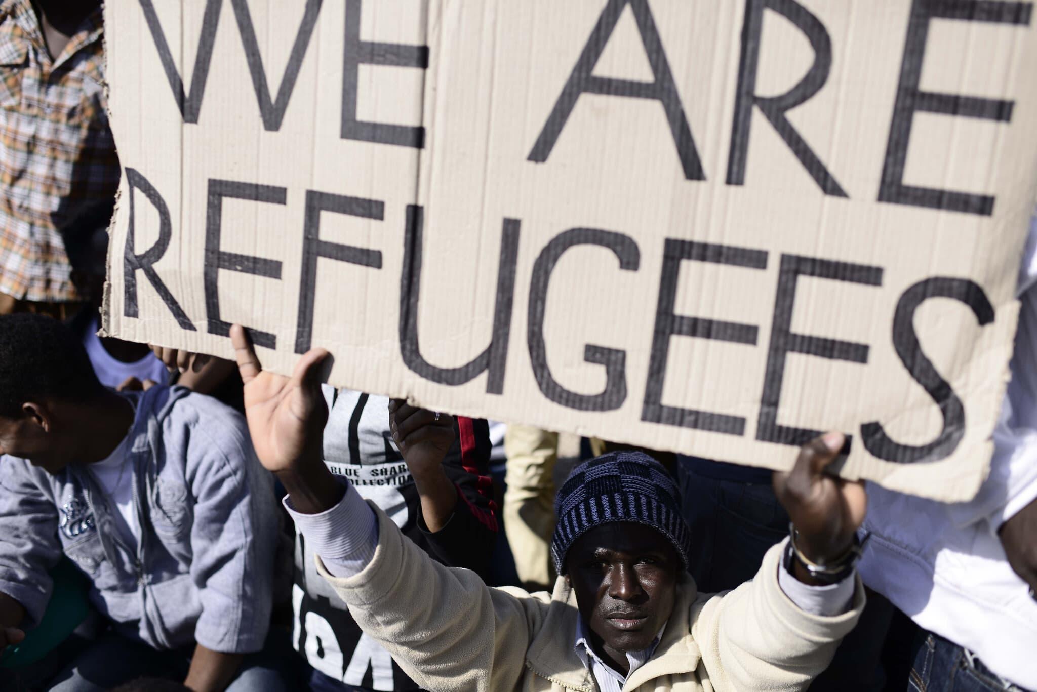 """הפגנת מבקשי מקלט, ביניהם מאריתראה וסודן, מול שגרירויות ארה""""ב ואירופה בתל אביב, ינואר 2014 (צילום: תומר נויברג/פלאש90)"""