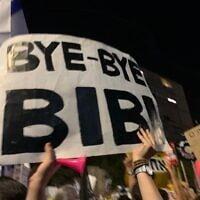 שלט בהפגנה בבלפור (צילום: ניצן ויסברג)