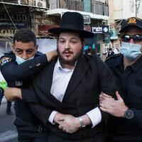 עימותים בין שווטרים למפגינים במאה שערים בירושלים (צילום: Nati Shohat/Flash90)