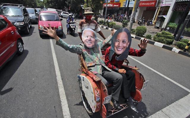 אילוסטרציה, תומכים של ביידן והאריס באינדונזיה, נובמבר 2020 (צילום: AP Photo)