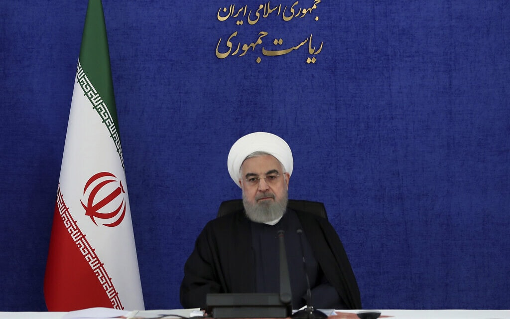 נשיא איראן חסן רוחאני נשבע לנקום על חיסולו של מוחסן פחריזאדה, ב-28 בנובמבר 2020 (צילום: Iranian Presidency Office via AP)