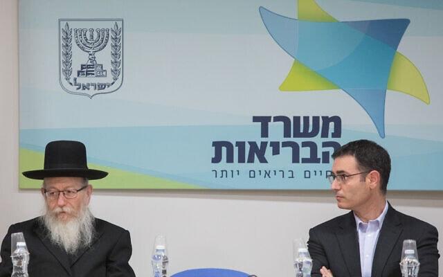 יעקב ליצמן (משמאל) ומשה בר סימן טוב (צילום: Noam Revkin Fenton/Flash90)