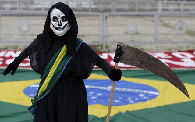 הפגנה בברזיל נגד הממשלה על הטיפול הכושל בנגיף הקורונה, 17 בינואר 2021 (צילום: AP Photo/Eraldo Peres)