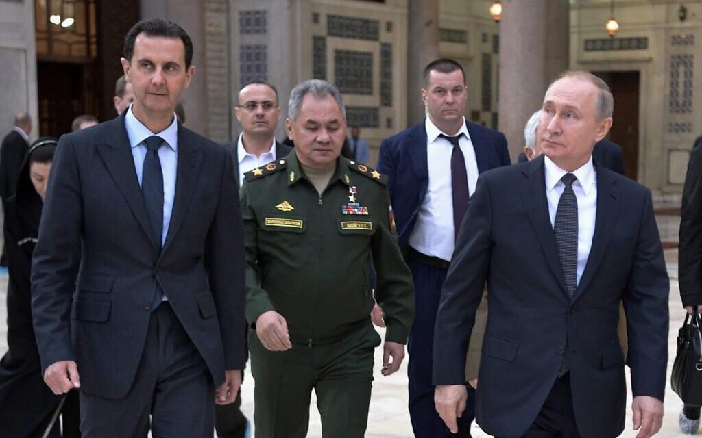 נשיא רוסיה ולדימיר פוטין, מימין, עם נשיא סוריה בשאר אל-אסד, משמאל, בדמשק. 7 בינואר 2020 (צילום: Alexei Nikolsky/Sputnik, Kremlin Pool Photo via AP)