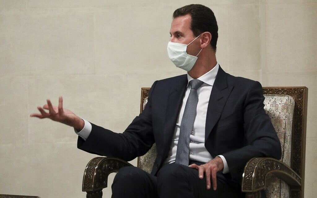 בשאר אל-אסד (צילום: Russian Foreign Ministry Press Service via AP)