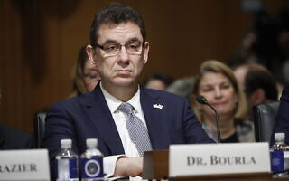 FILE – In this Feb. 26, 2019 file photo, Albert Bourla, chief executive officer of Pfizer, prepares to testify before the Senate Finance Committee hearing on drug prices, on Capitol Hill in Washington. Bourla urged global governments not to reopen economies too quickly because of the optimism created by possible COVID-19 vaccines. He says the vaccine is one tool in controlling the disease. Bourla was speaking Wednesday, Dec. 2, 2020, during an online event hosted in his native Greece. (AP Photo/Pablo Martinez Monsivais, File) (צילום: AP Photo/Pablo Martinez Monsivais)