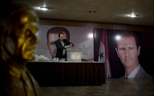 קלפי בדמשק בחירות הפרלמנטריות בסוריה, 13 באפריל 2016 (צילום: AP Photo/Hassan Ammar, File)