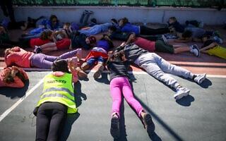 אילוסטרציה: ילדים בבית ספר באזור שער הנגב בעת התראת צבע אדום (צילום: פלאש90)