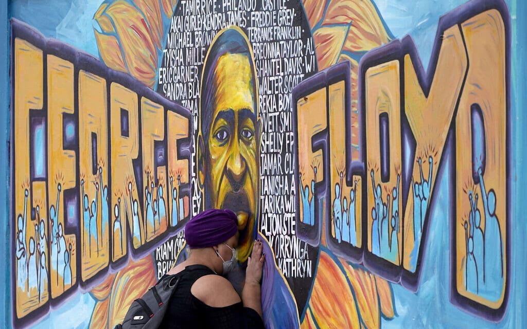 ציור קיר לזכרו של ג'ורג' פלויד במיניאפוליס (צילום: AP Photo/Julio Cortez)