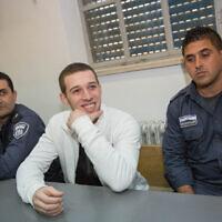 יצחק גבאי פעיל להב״ה שהורשע בהצתת בית הספר הדו-לשוני בשימוע, 29.11.2014 (צילום: Yonatan Sindel/Flash90)