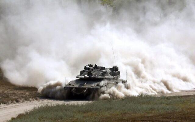 טנק צהלי בגבול עזה (ארכיון), צילום AFP (צילום: AFP)