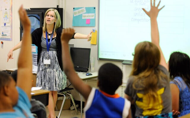 איימי לוסון מלמדת אנגלית תלמידי כיתה ה' בבית ספר יסודי בדלאוור, 1 באוקטובר 2013 (צילום: Steve Ruark, AP)