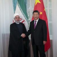 נשיא איראן לשעבר חסן רוחאני ונשיא סין שי ג'ינפינג, 14 ביוני 2019 (צילום: Iranian Presidency Office via AP))